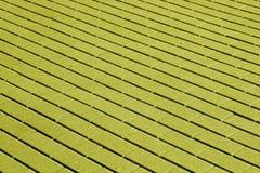 Kopfsteinsteinstraßenbelagmuster im gelben Ton Lizenzfreies Stockfoto