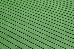 Kopfsteinsteinstraßenbelagmuster im grünen Ton Lizenzfreie Stockbilder