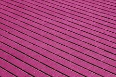 Kopfsteinsteinstraßenbelagmuster im rosa Ton Stockbilder