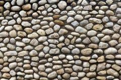Kopfsteinsteinwand Stockbild