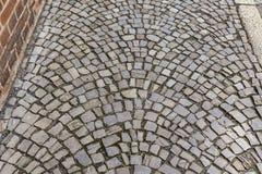 Kopfsteinweg mit gelegentlichem Muster Stockfotos