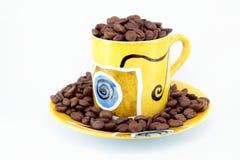 Kophoogtepunt van coffebonen stock afbeelding