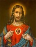 Kopian av den typiska katolska bilden av hjärta av Jesus Christ från Slovakien skrivev ut på 19. april 1899 Arkivbilder