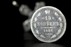 15 kopiejek Rosyjski imperium przeciw tłu zamazany srebro krzyżują fotografia stock
