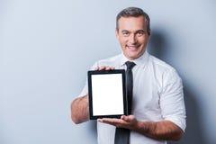Kopieren Sie Raum auf seiner Tablette Stockbilder