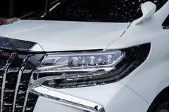 Koplamp 14 van de hand schoonmakende auto royalty-vrije stock afbeelding