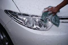 Koplamp 4 van de hand schoonmakende auto royalty-vrije stock foto