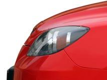 Koplamp van de rode auto stock afbeelding
