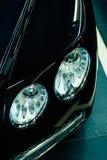 Koplamp van een modern concept van de luxe zwart auto in de garage royalty-vrije stock foto