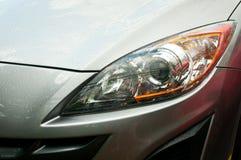 Koplamp van grijze auto Royalty-vrije Stock Afbeeldingen