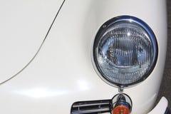 Koplamp van oud uitstekend autoclose-up royalty-vrije stock foto's