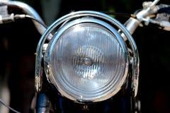 Koplamp van uitstekende motorfiets Stock Foto's