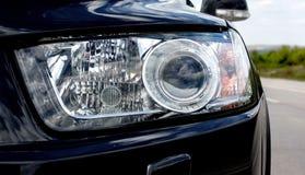 Koplampen moderne auto royalty-vrije stock fotografie