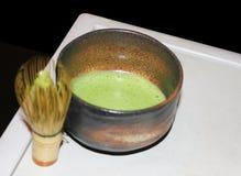 Kopp av grönt japanskt te Royaltyfri Fotografi