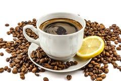 Kopp av kaffe med korn Arkivfoton