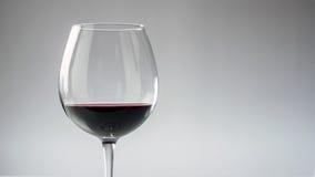 Kopp av rött vin Arkivfoto
