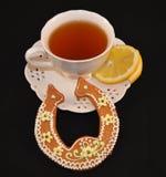 Kopp av smakligt te Arkivfoto