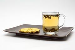 Kopp av tea med kexar Royaltyfri Fotografi