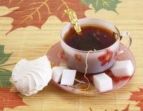 Kopp av tea och zephyren Arkivbilder