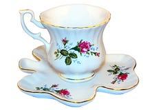 Kopp för te med tefatet Arkivfoton