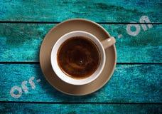 Kopp kaffe med av och på Fotografering för Bildbyråer
