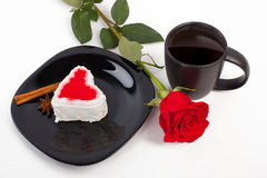Kopp kaffe med en ros Fotografering för Bildbyråer