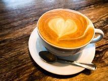 Kopp kaffe med förälskelse royaltyfri bild
