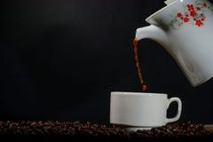 Kopp kaffe med krukan Royaltyfri Foto