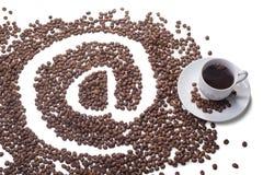 Kopp kaffe med på symbol Fotografering för Bildbyråer