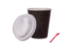 Kopp kaffe med skopan Arkivbilder