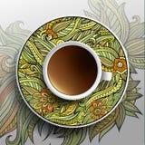 Kopp kaffe och blom- prydnad Arkivbild