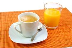 Kopp kaffe och glass orange fruktsaft frukost Royaltyfri Bild
