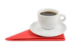 Kopp kaffe på servett Arkivfoto