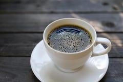 Kopp kaffe på trä Royaltyfri Fotografi