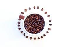 Kopp kaffebönor Arkivfoto