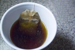 Kopp med avkoken Royaltyfri Foto