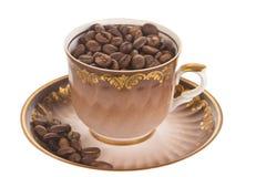 Kopp mycket av kaffebönor Arkivbild