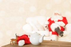 Kopp te för jultomten Fotografering för Bildbyråer