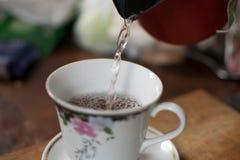 Kopp te för tevännerna Royaltyfri Bild