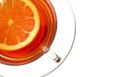 Kopp te med citronen på vit backrgound royaltyfri fotografi