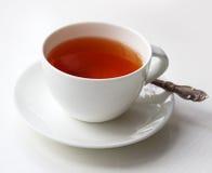 Kopp te med en sked Fotografering för Bildbyråer
