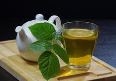 Kopp te med nötkreatur Arkivfoton