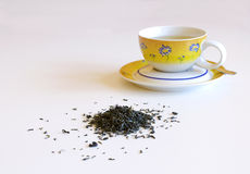 Kopp te med skeden Arkivfoton