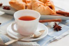 Kopp te med teskeden Arkivfoto