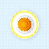 Kopp te på en blå bakgrund Arkivbild