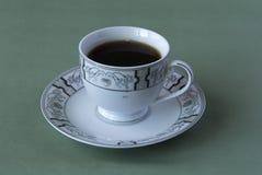 Kopp te på en maträtt Arkivfoto