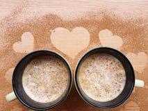 Koppar av cappucino på träbakgrund Royaltyfria Bilder
