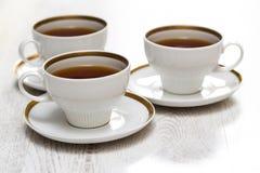 Koppar med te eller kaffe Arkivbilder