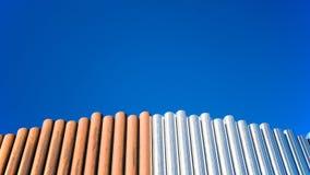 Koppar- och rostfritt stålrör Arkivfoto