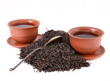 Koppen met thee en de lepel Stock Fotografie